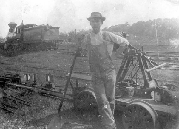 Unidentified Seaboard Air Line Railway crewman by hand car - Tallahassee Region, Florida.