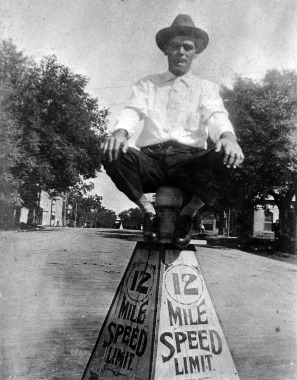 """""""Mac"""" Malcolm Daniel McCoy seated on a speed limit sign - Tallahassee, Florida."""