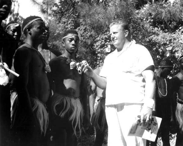 Wakulla Spring manager Newt Perry with actors portraying Bantu warriors - Wakulla Springs, Florida.