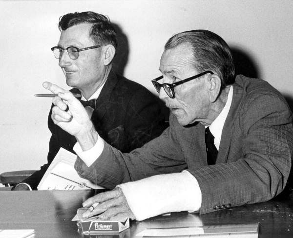 Representative Charles E. Miner (right) asking questions during a road committee hearing - Tallahassee, Florida.