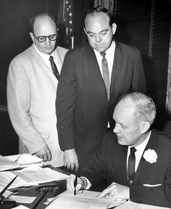 Governor Farris Bryant signing a bill revoking the Boulougne charter - Tallahassee, Florida.