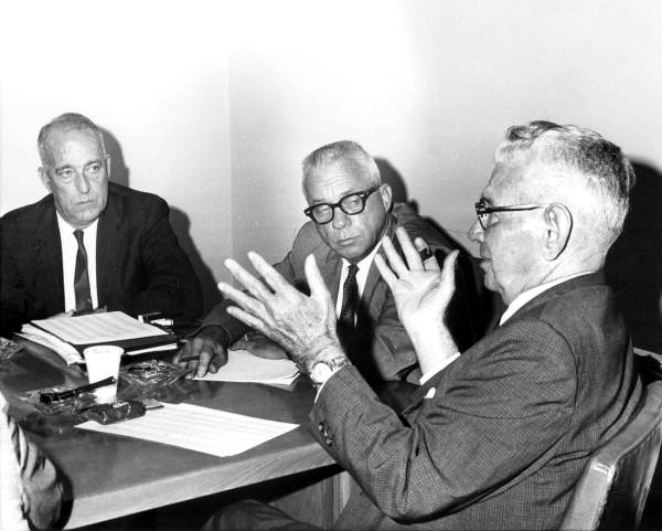 Representative S.C. Smith (right) explaining a proposed bill in a House committee meeting - Tallahassee, Florida.