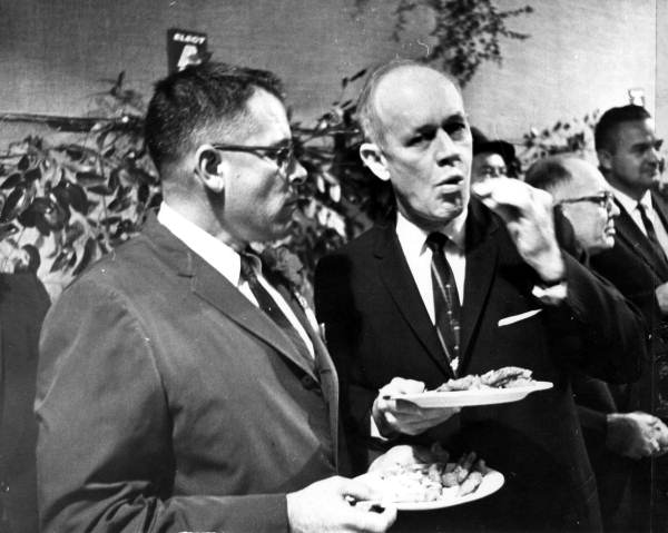 Secretary of State Tom Adams (left) and Governor Farris Bryant eating fish fry at Fair Grounds - Tallahassee, Florida.