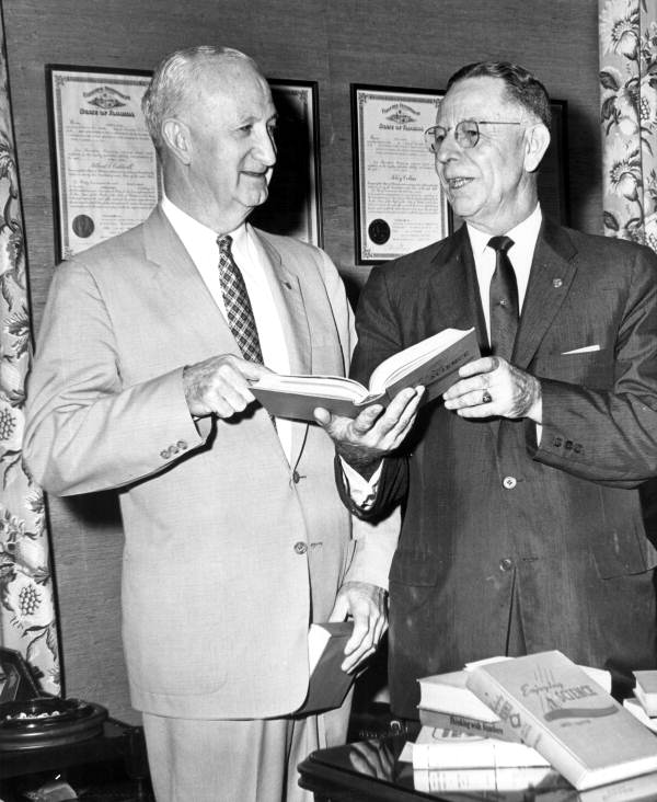 Superintendent of Public Instruction Thomas D. Bailey (right) and J.K. Chapman looking over obsolete textbooks - Tallahassee, Florida.