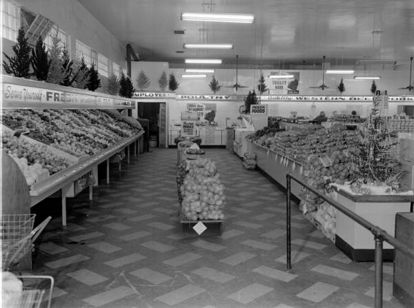 View of Christmas decorations in the produce section at a Lovett's Food Store - Jacksonville, Florida.