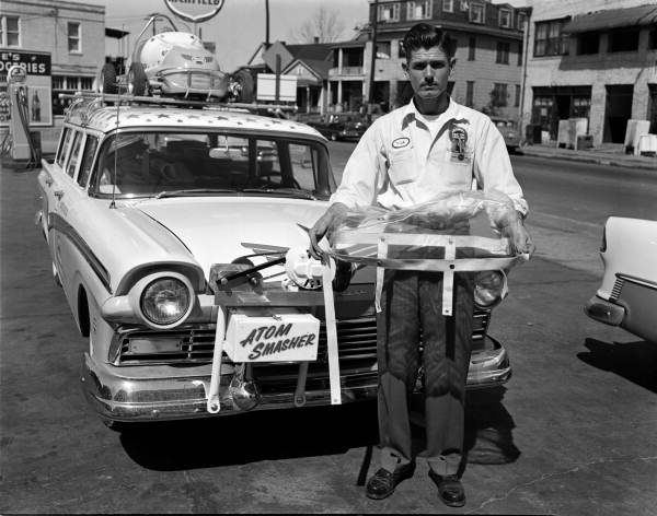 Man with promotional vehicle for Wynn Oil at Richfield gas station - Jacksonville, Florida.