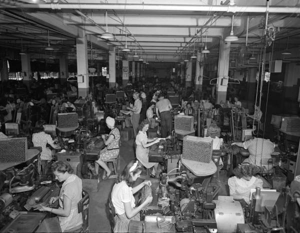 Interior view showing employees working inside the King Edward Cigars factory - Jacksonville, Florida.