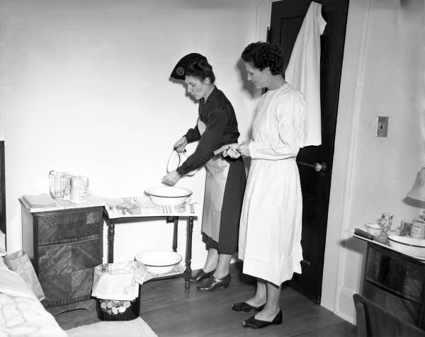 Public health nurse demonstrating proper handwashing technique in Tampa, Florida.