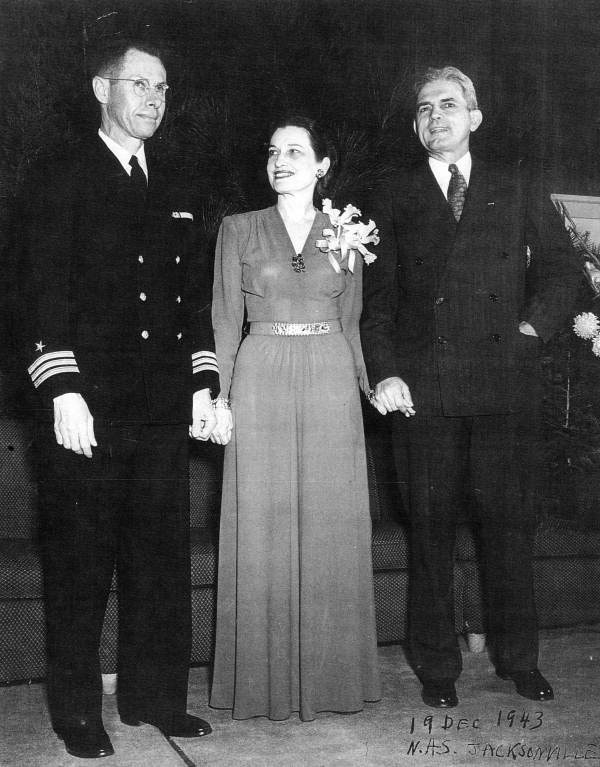 Commander Curtis E. Chillingworth with Governor and Mrs. Holland at N.A.S. Jacksonville.