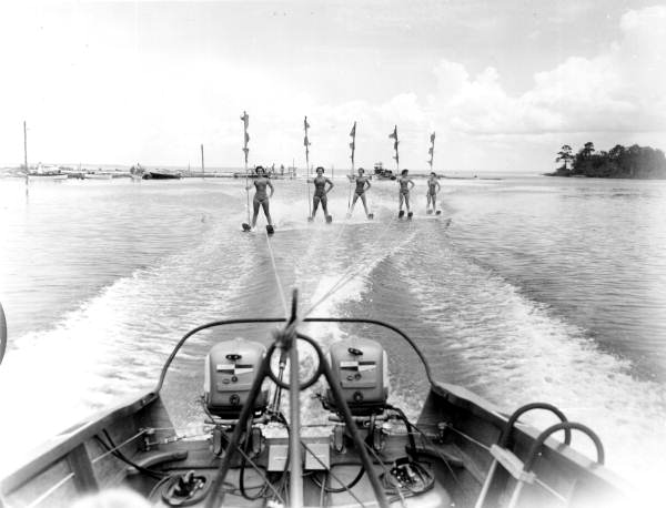 Boats pull water skiers across the water - Tallahassee, Florida .