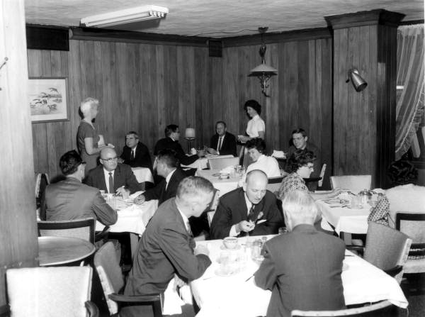 Diners and wait staff at the Cherokee Hotel's restaurant - Tallahassee, Florida .