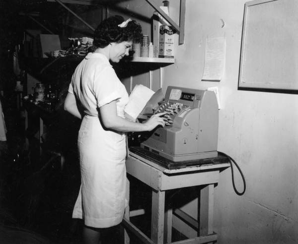 Unidentified waitress at the cash register - Tallahassee, Florida .