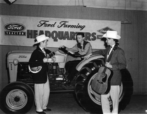 Jesse McReynolds, Jim McReynolds and Jack Ridner with a tractor - Tallahassee, Florida .