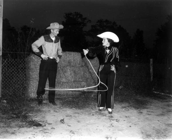 Unidentified woman performs rope tricks for Jack Ridner - Tallahassee, Florida .