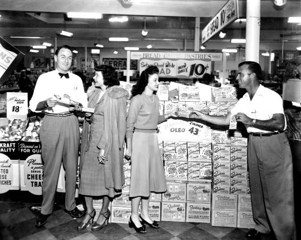 Men demonstrating the Parkay products at the grocery.
