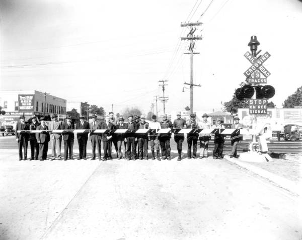 Group from Atlantic Coast Line at railroad crossing.