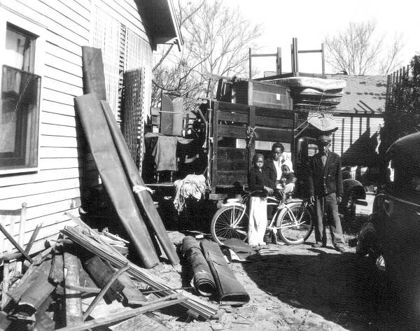 Family preparing their belongings to move to a new home.