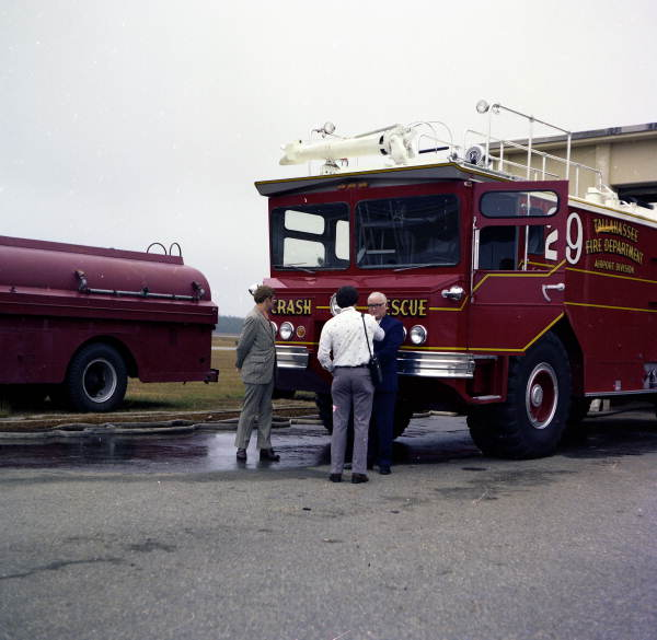 WCTV reporter Frank Ranicky with assistant chief Thomas Ridgway Coe in front of TFD Airport Division Crash Rescue truck #29 in Tallahassee, Florida.