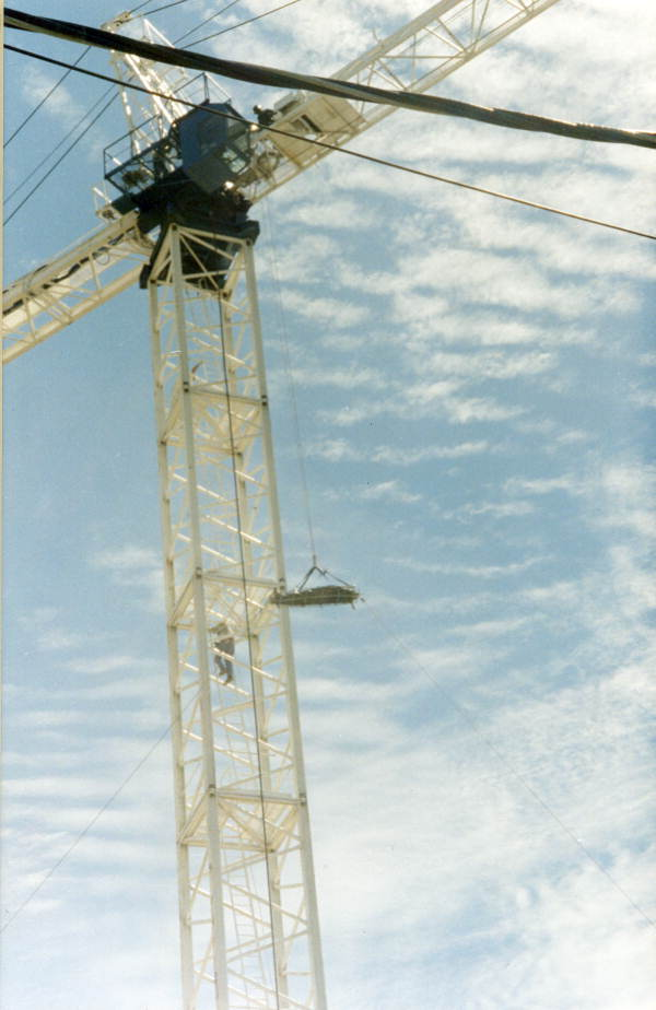 TFD firefighters lowering a basket stretcher from a tower crane - Tallahassee, Florida.